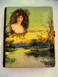 Antique celluloid photo album lake scene with lady cameo portrait