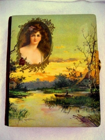 Antique Victorian celluloid photo album with lake scene and lady cameo portrait