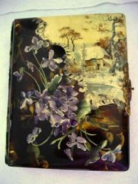 Antique Victorian celluloid photo album with embossed violets and a winter cottage scene