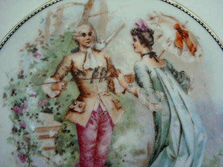 Antique hand mirror porcelain garden scene with Victorian couple