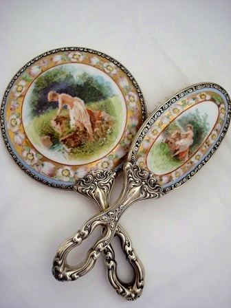 Antique Art Nouveau and German Silver porcelain backed hand mirror brush set scenic figural painted on porcelain