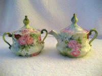 Bavarian 1800's covered creamer and covered sugar bowl hand painted in lush roses