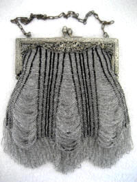 Early 1900 crystal beaded on black purse drippy swag design