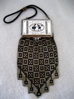 Whiting Davis figural compact mesh purse with puffs, comb and mirror