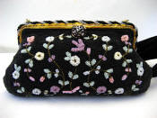Black beaded French evening handbag with rich pastels in lavender pink, ca. 1930's