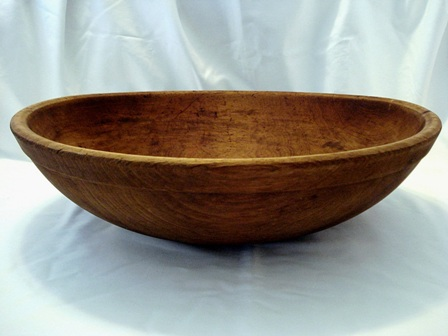 Antique 19 inch hand turned dough bowl with outer lip